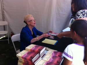 Marilyn Holdsworth signs books