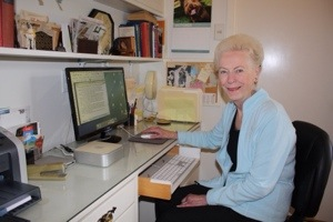 Marilyn Holdsworth at her computer